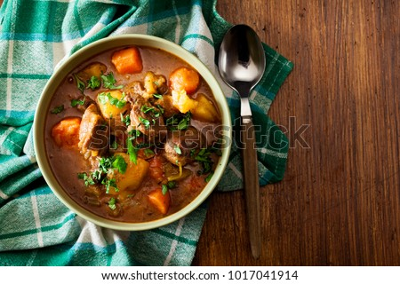 Irish stew made with beef, potatoes, carrots and herbs. Traditional  St patrick's day dish. Top view #1017041914