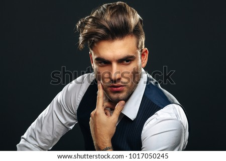 Portrait od handsome man in studio on dark background #1017050245