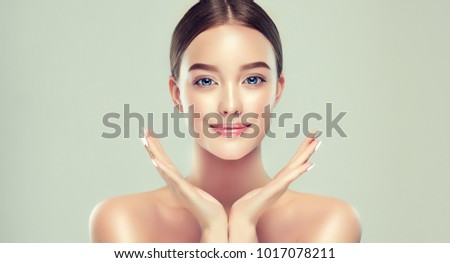 Beautiful young woman with clean fresh skin. Girl beauty face care. Facial treatment. #1017078211