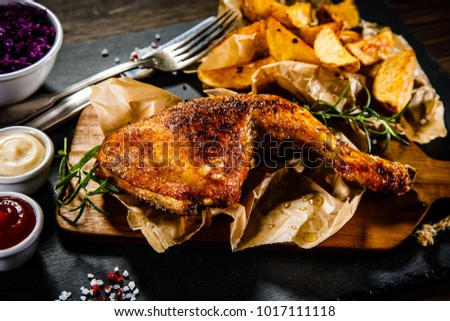 Grilled chicken legs with French fries and vegetables #1017111118