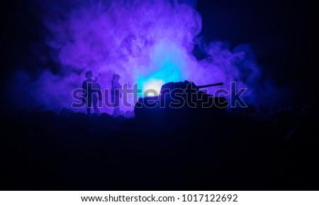 War Concept. Military silhouettes fighting scene on war fog sky background, World War Soldiers Silhouettes Below Cloudy Skyline At night. Attack scene. Armored vehicles. Tanks battle. Decoration #1017122692
