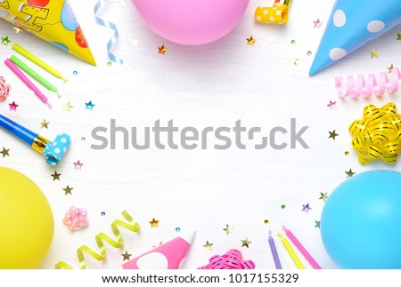 Birthday party background with party hats, balloons and streamers. Top view. Space for text.