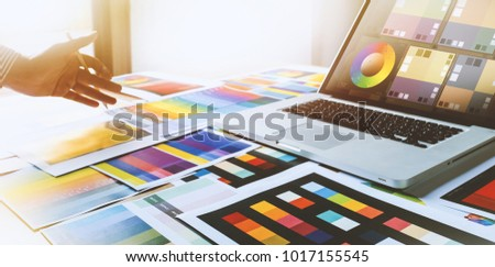 Graphic designer at work Creativity renovation and technology concept Color swatch samples for selection coloring studio