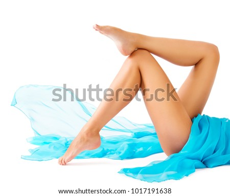 Woman Legs Beauty, Female Smooth Body, Leg Skin Care and Hair Removal concept, Girl Lying on White background #1017191638