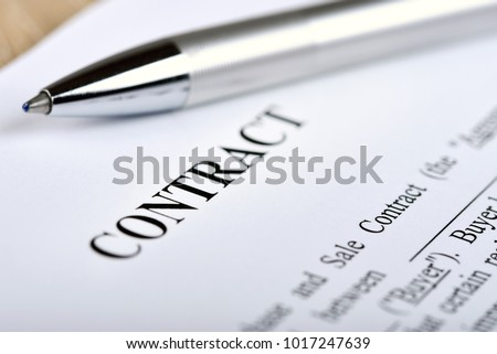 Legal contract signing - buy sell real estate contract #1017247639