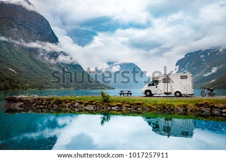 Family vacation travel RV, holiday trip in motorhome, Caravan car Vacation. Beautiful Nature Norway natural landscape. #1017257911