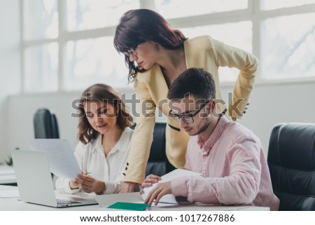 Business team working on a project in office #1017267886