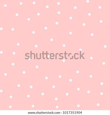 white polka dot on pink background