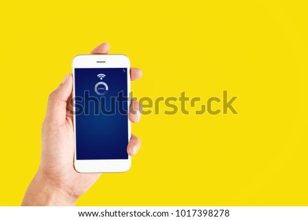 hand holding using mobile phone with WiFi symbol #1017398278