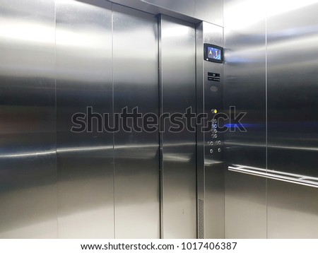 View inside an empty elevator or lift #1017406387