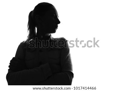 Female person silhouette,back lit light #1017414466