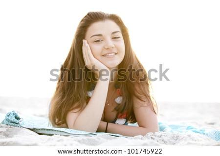 Brunette girl at the beach in sunrise. #101745922