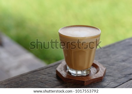 Late art coffee with heart shape on wood table background. #1017553792