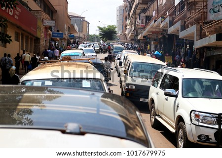 Kampala, Uganda - June 6, 2016: Heavy traffic in the center of Kampala. Kampala is the capital city of Uganda in Africa. Busy life in downtown Kampala. The town is chaotic and overpopulated.  #1017679975