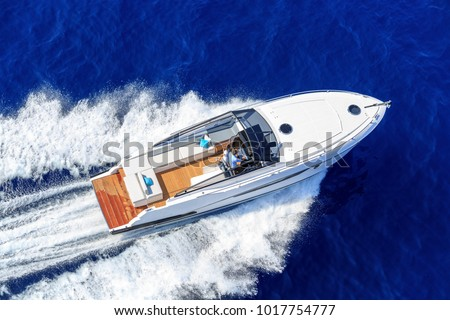 aerial view couple on luxury motor boat #1017754777