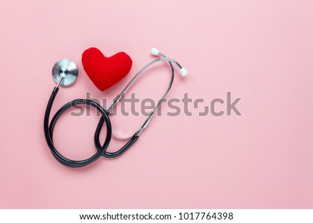 Table top view aerial image of accessories healthcare & medical background concept.Red heart & stethoscope on pink paper.Flat lay of idea for doctor treat patient in hospital.space for design.  #1017764398