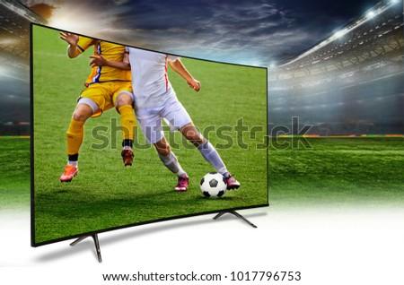 4k monitor watching smart tv translation of football game. #1017796753