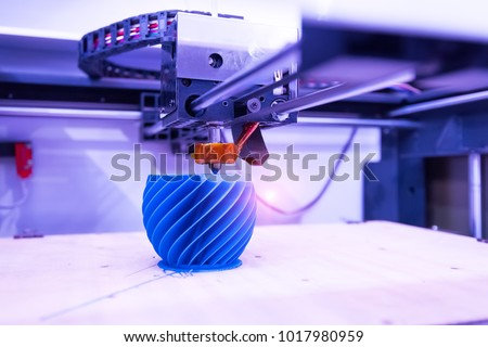 3D printer or additive manufacturing and robotic automation technology.