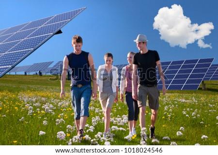 People walking by solar panels #1018024546