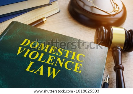 Domestic violence law on a wooden table. #1018025503