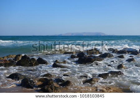 Summer morning by the sea in Kokkini Hani on the island of Crete #1018103845