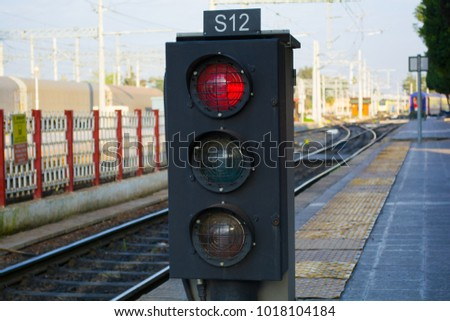 traffic light shows red signal on railway; railway station #1018104184