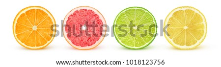 Isolated citrus slices. Fresh fruits cut in half (orange, pink grapefruit, lime, lemon) in a row isolated on white background with clipping path #1018123756