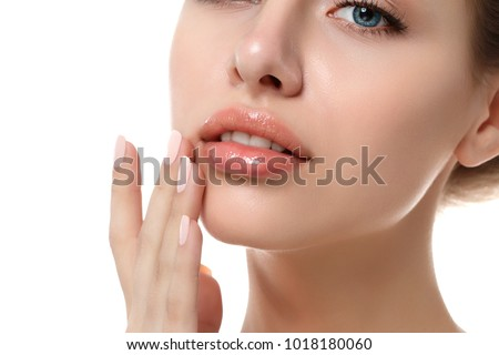 Close up view of young beautiful caucasian woman face isolated over white background. Lips contouring, SPA therapy, skincare, cosmetology and plastic surgery concept
