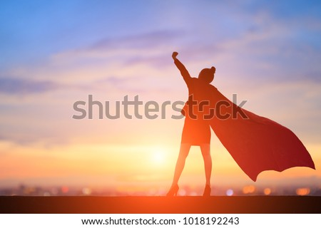 silhouette of super business woman feel excited with sunset Royalty-Free Stock Photo #1018192243