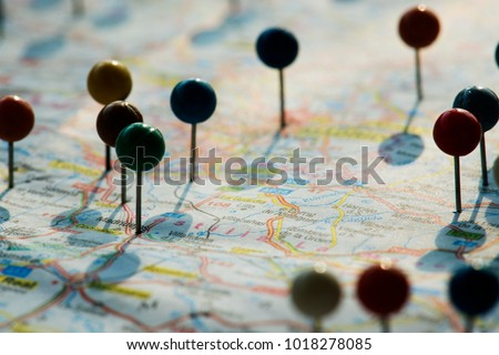 Closeup of pins on the map planning travel journey Royalty-Free Stock Photo #1018278085