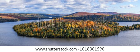 Fall foliage vista of the Superior National Forest. View on Caribou Lake, North Shore of Lake Superior, Minnesota. Royalty-Free Stock Photo #1018301590