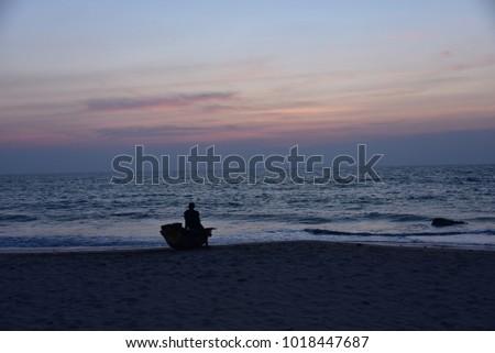Man Pondering Life at Sunset in Burma #1018447687