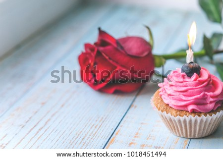 cupcake with candle on birthday Template for a postcard #1018451494