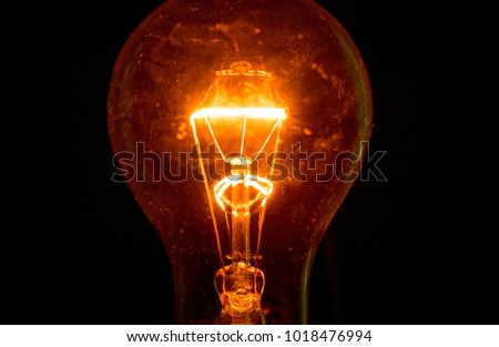 Light bulb on a black background #1018476994