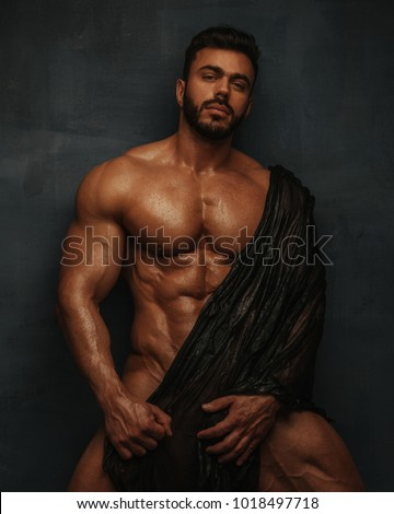 Naked bodybuilder with wet textile #1018497718