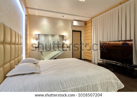 bedroom with a beautiful interior #1018507204