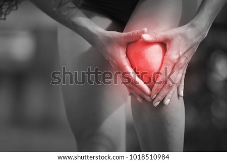 Female athlete runner touching foot in pain, due to knee #1018510984