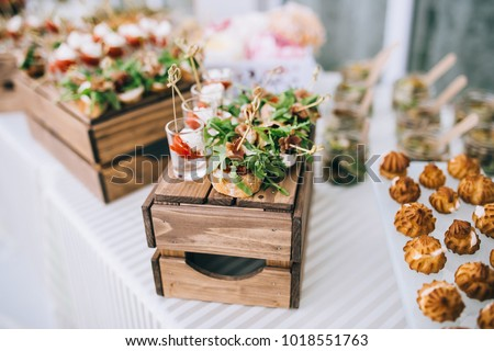 Beautifully decorated catering banquet table with different food snacks and appetizers with sandwich #1018551763