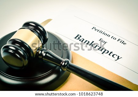 Bankruptcy document with wooden gavel, Buseniss concept. Royalty-Free Stock Photo #1018623748