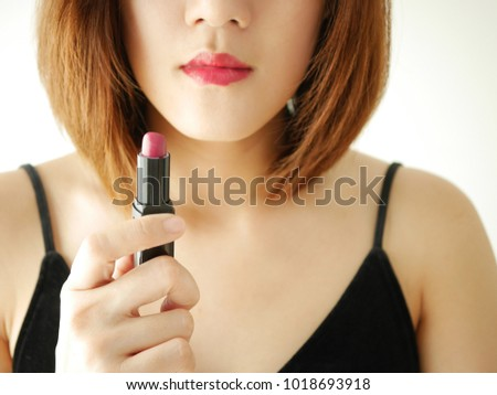 portrait young asian model woman applying or wearing lip stick cosmetic, red ,pink ,make up and cosmetic .isolated white background. #1018693918
