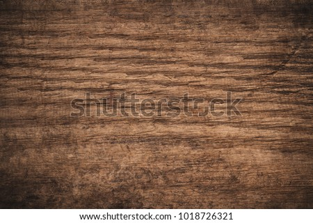 Old grunge dark textured wooden background,The surface of the old brown wood texture,top view brown wood panelitng #1018726321
