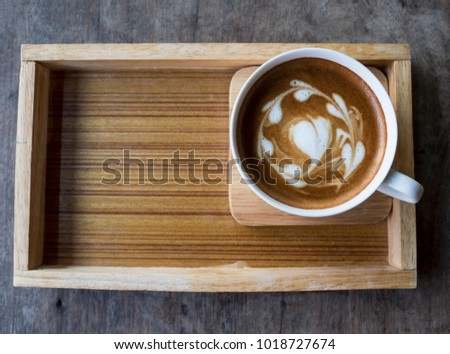 white cup of coffee Latte with hearts shape on wooden board #1018727674