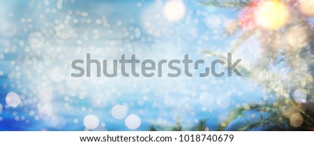 Bokeh light background.  Holiday glowing backdrop. Defocused Background With Blinking Stars. Blurred Bokeh. #1018740679