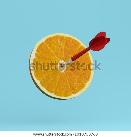 Orange fruit with circular target marked and red dart on pastel blue background. minimal idea food and fruit concept. An idea creative to produce work within an advertising marketing communications  #1018753768