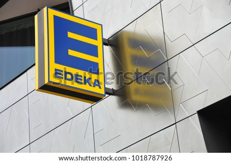 Berlin / Germany - July 22, 2017: Sign at the entrance to an EDEKA store in Berlin, Germany  -  The EDEKA Group is the largest German supermarket corporation #1018787926