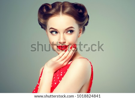 Pin up girl vintage. Wow expressions emotion! Beautiful woman pinup style portrait in retro dress and makeup, manicure nails hands, red lipstick and polka dot dress, surprised face. #1018824841