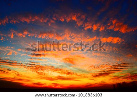 sunset sky with red and orange clouds  #1018836103