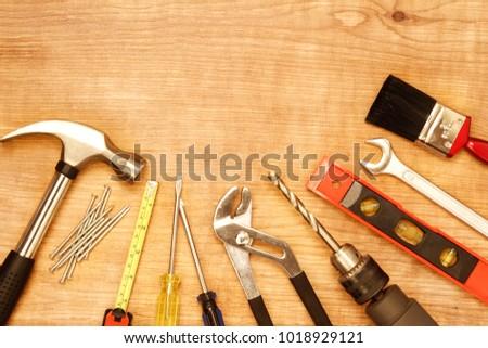 Assorted work tools on wood #1018929121