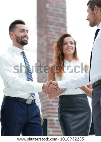 closeup.welcome and handshake of business partners #1018932235