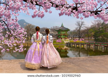 Cherry Blossom in spring with Korean national dress at Gyeongbokgung Palace  Seoul,South Korea. #1019002960